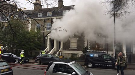 There are 20 firefighters at the scene near the Flask pub. Photo: Ian White