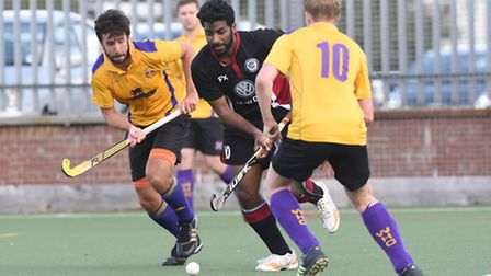 Laxman Karan (centre) maintained his record of scoring in every game this season, but West Hampstead