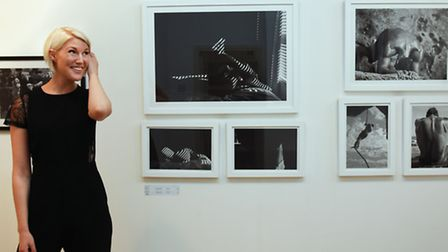 Sussie in front of the photos in her exhibition. (Photo: Rebecka Slatter)