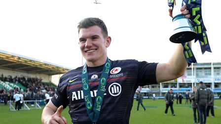 Saracens' Ben Spencer celebrates with the trophy after Saracens' victory in the Anglo-Welsh Cup fina