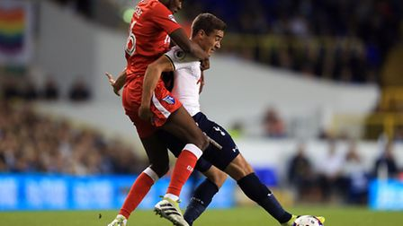 Harry Winks (right) holds off Gillingham's Emma Osaoabe during Tottenham's third-round tie in the EF