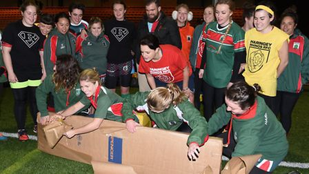 The Haringey players unpack one of their parcels. Pic: Paolo Minoli