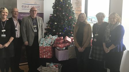 ECCH chief executive Jonathan Williams (third from left) and ECCH staff present their Christmas gift