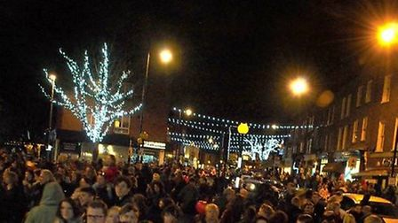 The Highgate Christmas lights in their heyday. People crowd into South Grove to see Alex Zane switch