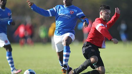 Action from the Hackney & Leyton League, where Highfield (blue) beat Top Red 4-1. Pic: George Philli