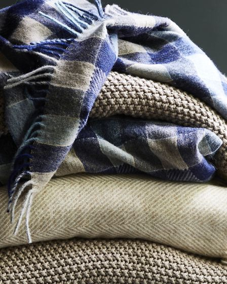 Multi Patchwork Throw in blue £85 , Moss Stitch Throw in natural, £60, Herringbone Throw in gold lur