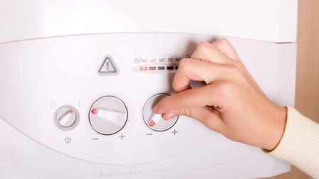 A person turning up their boiler. PA Photo/thinkstockphotos