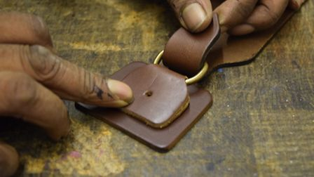 The buckle for the bags being made