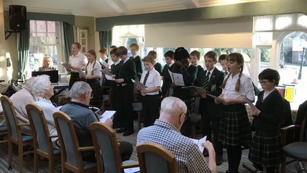 Pupils from Saint Felix School in Reydon performing carols at Broadlands Care Home in Oulton Broad.