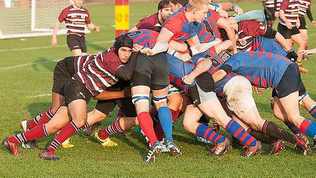 UCS Old Boys (in maroon) battle to repel a drive from the Old Streetonians forwards. Picture: Nick C