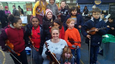 A violin teacher and several of her students held a busking session in Broadway Market, Hackney, to