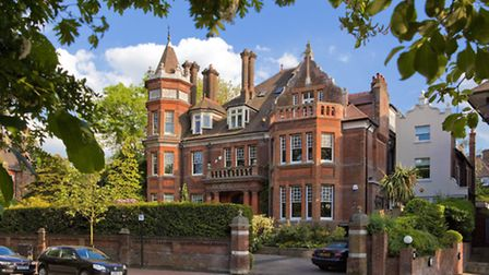 Forming part of a sprawling red brick building straight out of a Gothic fantasy, this five-bedroom f