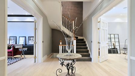 The property has a dramatic central staircase