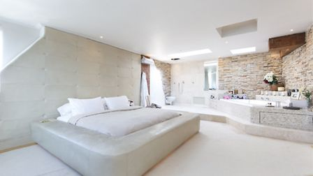 The master bedroom is palatially James Bond-style