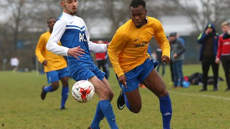 Action from the 4-4 draw between FC Krystal (blue/white) and Mile End in the Hackney & Leyton Sunday