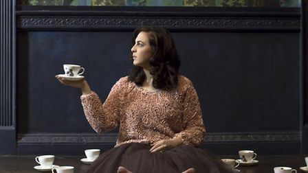 Ali Miller surrounded by tea cups