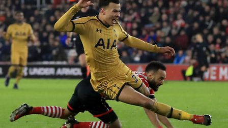 Tottenham's Dele Alli (left), who scored his side's first and last goals, is fouled by Nathan Redmon