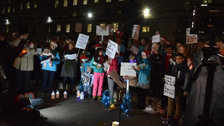 Carols for Nazanin, crowd of supporters gather on Whitehall opposite Downing Street to sing carols f