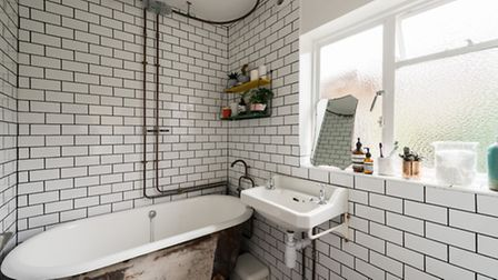 The cast iron bath has been altered to include a shower