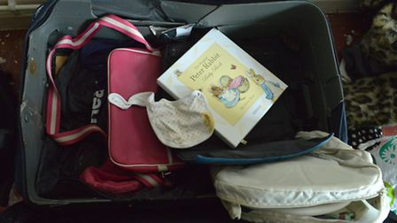 Treasured mementoes of Demi's baby son, including a bib and book, were found in her bedroom. Picture