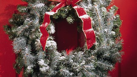 A Christmas wreath on a front door. PA Photo/thinkstockphotos