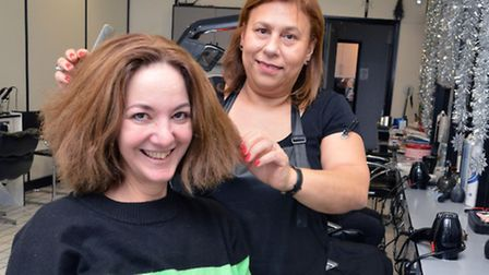 Stylist Sally Mehmet at Hairbase Plus with customer Joanna Tamar. Picture: Polly Hancock