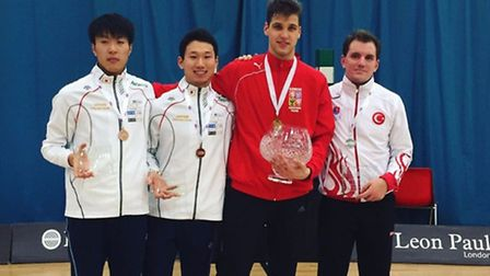 Alexander Choupenitch (second from right), pictured with his trophy and the other medalists