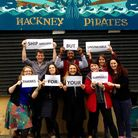 Hackney Pirates staff outside the damaged shop. Picture: Hackney Pirates