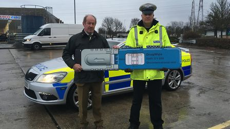 Suffolk's Police and Crime Commissioner Tim Passmore and Pc Paul Fletcher. Picture: ADAM HOWLETT