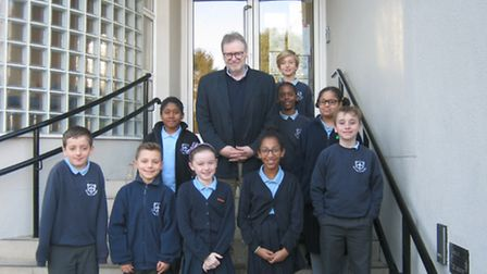Maurice Wren with Year 6 students from Our Lady of Muswell Catholic Primary School.
