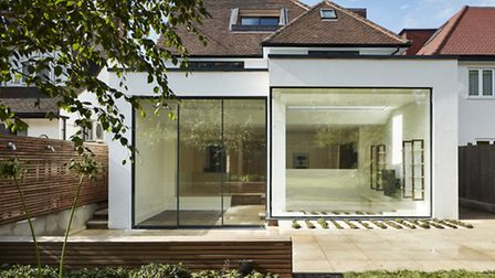 The once dark and cramped house has been reformed into a light filled and functional family home