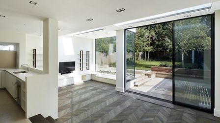 The sunken living area adds more ceiling height