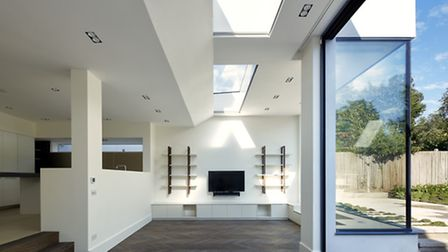 Skylights allow natural daylight to saturate the open plan living area