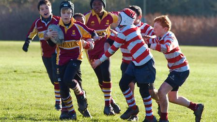 Luke Johnson (centre) attacks for Hampstead's Under-12 boys, supported by Martin Calavia (left) and