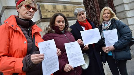 Delivering a letter to the Foreign Office from left Linda Grove, Jessica Learmond-Criqui, Tom Conti