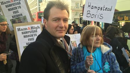 Protesters march alongside Richard Ratcliffe with his mother Barbara Ratcliffe