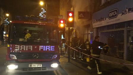 Fire crews put out the blaze at the funeral parlour (Photo: @999London)