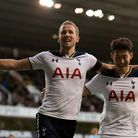 Harry Kane (left) struck twice and Heung-Min Son was also on target against Swansea at White Hart La