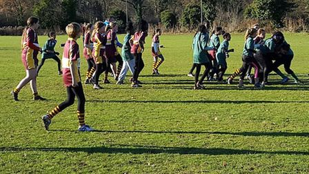 Hampstead's girls (in maroon) on the attack