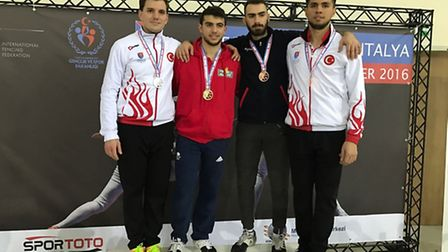 ZFW Fencing Club's Alex Tofalides (second from left) on the podium with his gold medal