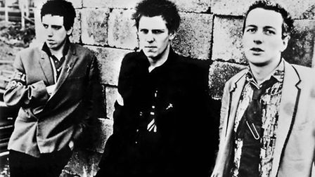 British punk rockers from the band The Clash, Joe Strummer, Mick Jones, and Paul Simonon pose for a