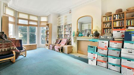Re-think the carpets and built-in storage to make the most of the high ceilings and original feature