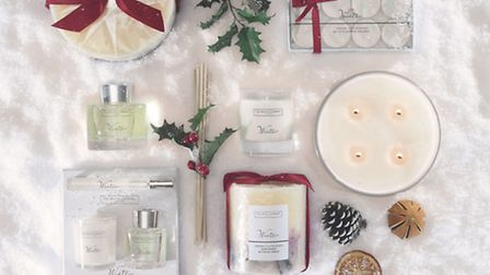 The Winter collection: Indulgence candle, (four wick) £130; botanical pillar candle (with red bow),