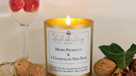 Merry Prosecco and A Champagne New Year scented candle, £19.99, available from The Oak Room. PA Phot