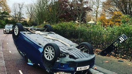 The driver managed to flip the BMW near a pavement. Photo: Justin McKie