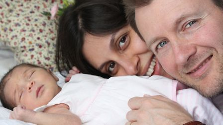 Nazanin with husband Richard and newborn baby Gabriella in West Hampstead