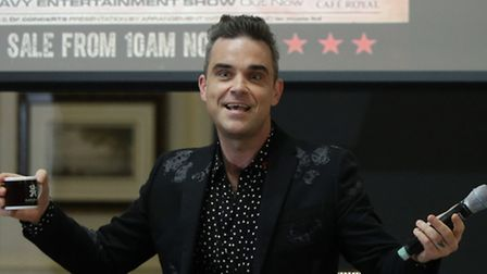 Robbie Williams: Playing in a church. Picture: Yui Mok/PA Wire