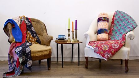 Soft furnishings, candles and vintage armchairs