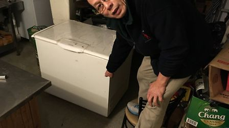 Alex points out how high the water was in his basement. All of his fridges and units were ruined.
