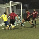 Anthony McDonald (left) shoots between the goalkeeper's legs from a tight angle to score Haringey's